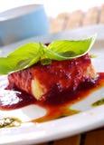 Panacotta. Classic italian dessert with raspberry sauce Royalty Free Stock Images