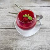 Panacotta dessert with ripe raspberries, sprinkled syrup Royalty Free Stock Image