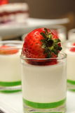 Panacotta dessert with strawberry on the top. Royalty Free Stock Image