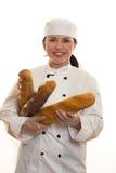 Panadero con las barras de pan imagen de archivo libre de regalías