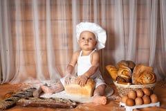 Panadero feliz del bebé fotos de archivo