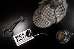 Panadero Street Sign And Sherlock Holmes Items On Black Table fotografía de archivo
