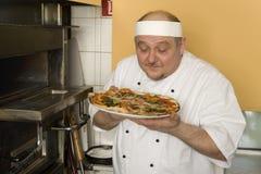 Panaderos de la pizza Foto de archivo libre de regalías