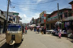 Panadura, Sri Lanka - May 10, 2018: View of the market street in Panadura city. Along the street there are many shops and boutiques royalty free stock photography