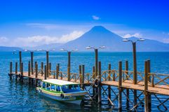 Panajachel, Guatemala -April, 25, 2018: The docks in Panajachel with San Pedro volcano in the background. A few small royalty free stock images