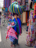 Panajachel Woman. PANAJACHEL, GUATEMALA - MARCH 2015 - A Lady shows off her things for sale in the town of Panajachel, Guatemala in March of 2015 Stock Photos