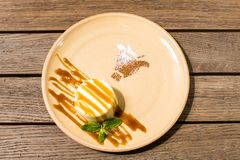 Panakota in a plate on a wooden table stock photo