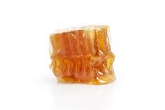 Panal con la miel aislada en blanco Fotos de archivo libres de regalías