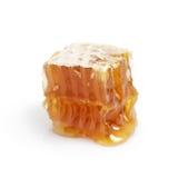 Panal con la miel aislada en blanco Imágenes de archivo libres de regalías