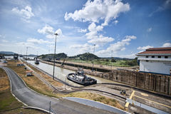 Panama canal. A tug boat transiting through Panama canal on a sunny day Stock Photo