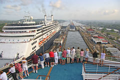 Panama Canal. The Panama Canal (Spanish: Canal de Panamá) Two Cruise ships pass each other in the Canal as passengers get close up look at locks royalty free stock photography