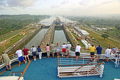 Panama Canal. The Panama Canal (Spanish: Canal de Panamá) is a 48-mile (77.1 km) ship canal in Panama that connects the Atlantic Ocean (via the Caribbean Sea stock photography