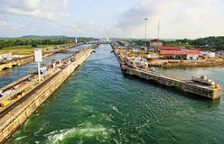 Panama Canal. The Panama Canal (Spanish: Canal de Panamá) is a 48-mile (77.1 km) ship canal in Panama stock image