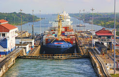 Panama Canal. The Panama Canal (Spanish: Canal de Panamá) is a 48-mile (77.1 km) ship canal in Panama that connects the Atlantic Ocean (via the Caribbean Sea) Stock Images