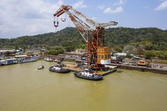 Panama canal, a crane on a floating platform. This is a crane installed permanently on a special floating platform, and designed to perform lifting and handling royalty free stock photos