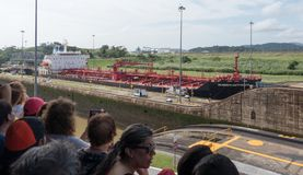 Audience watches as ship is moved through the Panama Canal. Panama Canal, Panama, Dec 5, 2017 - Audience watches as ship is moved through the Panama Canal Royalty Free Stock Images
