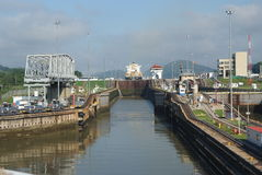 Panama Canal filling to raise a ship. Gates and basin of Miraflores Locks Panama Canal filling to raise a ship Stock Image