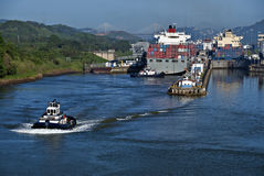 Panama Canal Locks. Container ships and a tug boat at the Miraflores Locks at the Panama Canal, linking the Atlantic and Pacific Oceans, and a major tourist stock photos
