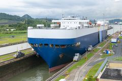 Panama Canal, Shipping, Freight, Travel. Panama Canal locks. A freight ship has passed through the lock. Central America is a popular travel destination for Royalty Free Stock Photos