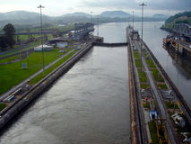 Panama Canal locks opening. Waiting for the locks to empty to lower our ship as we make our way through the Panama Canal locks of Central America Stock Photos