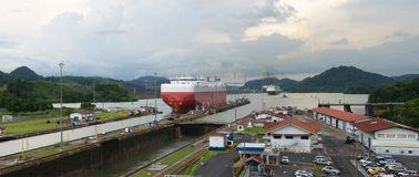 Panama Canal, Shipping, Freight, Travel. Panama Canal locks. A freight ship has passed through the lock. Central America is a popular travel destination for Royalty Free Stock Image
