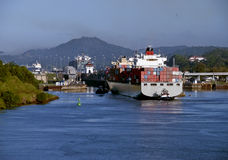 Panama Canal, Tugboat and Container Ship Stock Photo