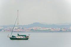 Panama City Casco Viejo. Sail boat and Casco Viejo in Panama City on the background on January 2, 2014 Stock Photo
