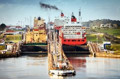 Oil tanker ship in panama canal. Panama City, Panama - February 20, 2015: A freighter entering the Canal locks of Miraflores in the Panama Canal, the Canal locks Stock Photography