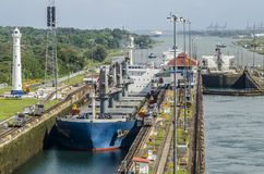 Oil tanker ship entering the Miraflores Locks in the Panama Canal. Panama City, Panama - February 20, 2015: Oil tanker ship entering the Miraflores Locks in the Royalty Free Stock Images