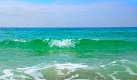 Panama City FL, golf av vatten Mexico för blå gräsplan Royaltyfria Bilder