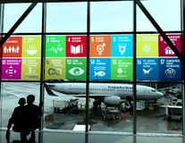 Global Goals displayed in Spanish at airport royalty free stock photos