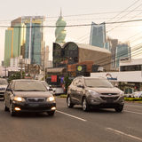 Panama city skyline and the busy road are seen at sunset in Pana Stock Photography