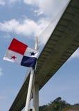Panama Flag and centennial Bridge. Panamanian flag and Centennial Bridge. The Centennial Bridge is a major bridge crossing the Panama Canal royalty free stock photos
