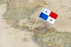 Panama flag pin on world map. Paper flag pin of Panama on a world map showing neighboring countries. Officially the Republic of Panama, it is a country in royalty free stock images