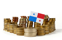 Panama flag with stack of money coins. Panama flag waving with stack of money coins Stock Photo
