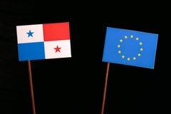 Panama flagga med EU-flaggan för europeisk union på svart Arkivbilder