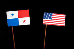 Panama flagga med USA flaggan på svart Royaltyfri Foto