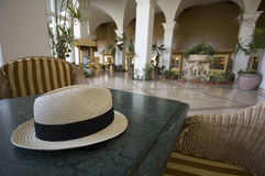 Panama hat. A panama hat on a table in a plush hotel lobby Royalty Free Stock Photo