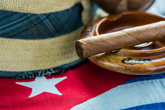 Panama hat on Cuban flag. Cuban flag, panama hat and musical instrumet.Vacation in Cuba concept Stock Photos