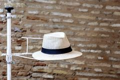 Panama hat on a display stand with a brick wall in the backgroun Royalty Free Stock Photography