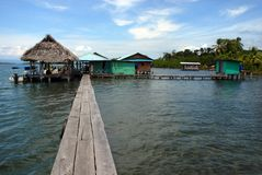 Panama house on Water. Palafitos with mangrove behind. Scuba diving station at the Caribbean Sea, Panama. Houses constructed in the water over tree trunks Royalty Free Stock Photo