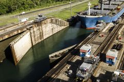 Panama, the Miraflores Canal locks open to let an oil tanker. The Miraflores Canal locks open to let an oil tanker enter the Panama Canal, the Channel locks are Stock Photo