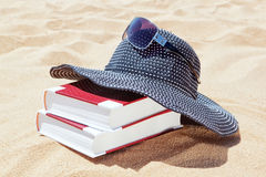 Panama for the sun with books. Stock Photos