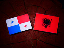 Panamanian flag with Albanian flag on a tree stump isolated Royalty Free Stock Photo
