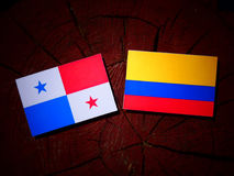 Panamanian flag with Colombian flag on a tree stump isolated Royalty Free Stock Photo