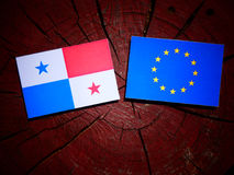 Panamanian flag with EU flag on a tree stump isolated. Panamanian flag with EU flag on a tree stump Stock Image