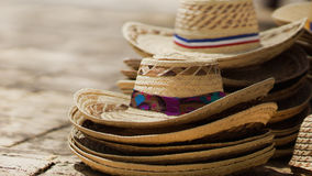 Panamas on the ground. Bunch of handmade panamas,  hats on the ground. Traditional sales in Dominican Republic Royalty Free Stock Images