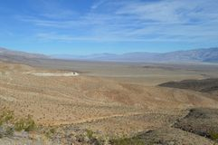 Panamint Valley Entry Path and Vista in California. Panamint Valley Vista from entry point. Sloping desert hill floors foreground, mountain range and floor in stock photos