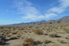 Panamint Valley Entry Path and Vista in California. Panamint Valley Vista from entry point. Sloping desert hill floors foreground, mountain range and floor in stock photography
