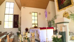 Awesome interior of modern new church. Altar pew and paintings in god house. PANARA, LITHUANIA - APRIL 22, 2018: Awesome interior of modern new church. Altar pew stock video footage